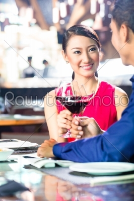 stock photo: asian couple fine dining in restaurant-Raw Stock Photo ID: 38397