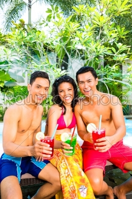 stock photo: asian friends drinking cocktails at pool-Raw Stock Photo ID: 38504