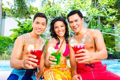 stock photo: asian friends drinking cocktails at pool-Raw Stock Photo ID: 38505