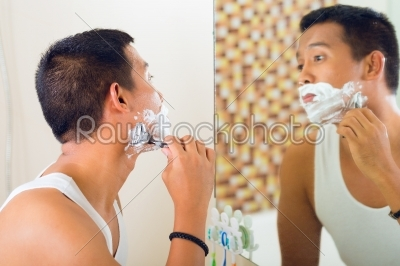 stock photo: asian man shaving in front of mirror-Raw Stock Photo ID: 43462
