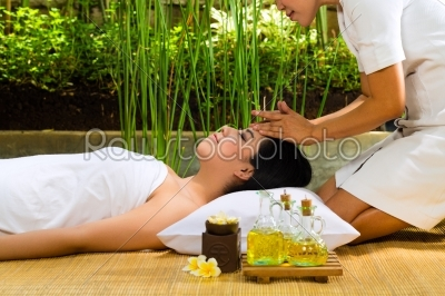 stock photo: asian woman having a massage in tropical setting-Raw Stock Photo ID: 44477