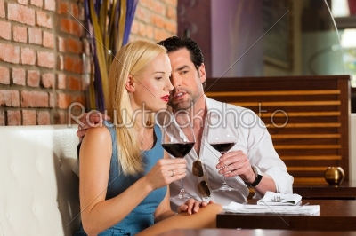 stock photo: attractive couple drinking red wine in restaurant or bar-Raw Stock Photo ID: 44447