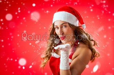 stock photo: attractive woman as santa claus blowing snow-Raw Stock Photo ID: 43481