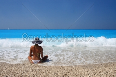 stock photo: beautiful young woman by the sea-Raw Stock Photo ID: 12530