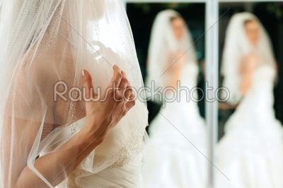 stock photo: bride at the clothes shop for wedding dresses-Raw Stock Photo ID: 41583