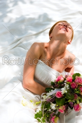 stock photo: bride sitting holding a bouquet of flowers in her hand-Raw Stock Photo ID: 39061