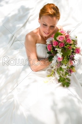 stock photo: bride sitting holding a bouquet of flowers in her hand-Raw Stock Photo ID: 39062