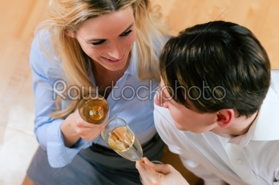 stock photo: business couple at home with champagne-Raw Stock Photo ID: 41287