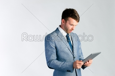 stock photo: businessman using tablet computer-Raw Stock Photo ID: 38823