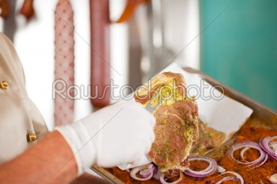 stock photo: butcher holding steak meat with fork-Raw Stock Photo ID: 41908