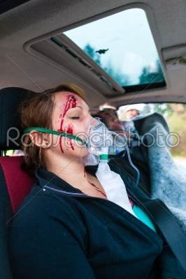stock photo: car accident  victim in crashed vehicle receiving first aid-Raw Stock Photo ID: 46764