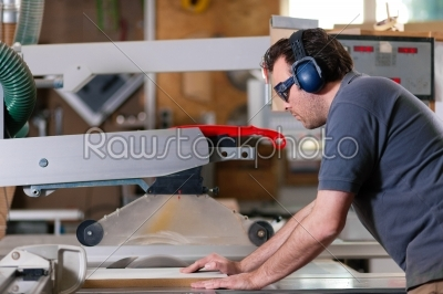 stock photo: carpenter using electric saw-Raw Stock Photo ID: 39476