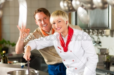 stock photo: chefs in a restaurant or hotel kitchen cooking-Raw Stock Photo ID: 39817