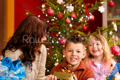 stock photo: christmas  family with gifts on xmas eve-Raw Stock Photo ID: 42682