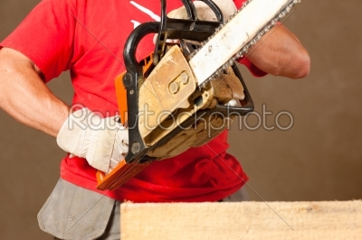 stock photo: construction worker with motor saw-Raw Stock Photo ID: 40000