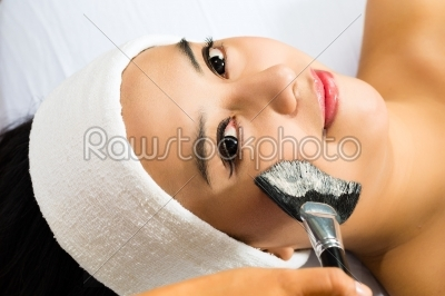 stock photo: cosmetics  asian woman gets a facial mask-Raw Stock Photo ID: 44487
