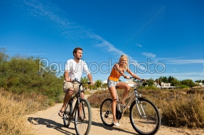 stock photo: couple in holidays cycling on beach-Raw Stock Photo ID: 40444