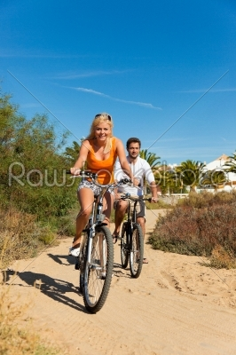 stock photo: couple in holidays cycling on beach-Raw Stock Photo ID: 40446