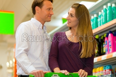stock photo: couple in supermarket with shopping cart-Raw Stock Photo ID: 39666