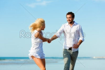 stock photo: couple on the beach running into glorious future-Raw Stock Photo ID: 40303