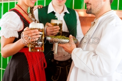 stock photo: couple with beer and their brewer in brewery-Raw Stock Photo ID: 43248