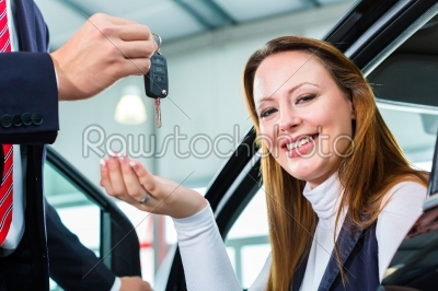 stock photo: dealer female client and auto in car dealership-Raw Stock Photo ID: 38669