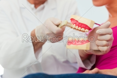 stock photo: dentist explaining teeth brushing to patient-Raw Stock Photo ID: 39280