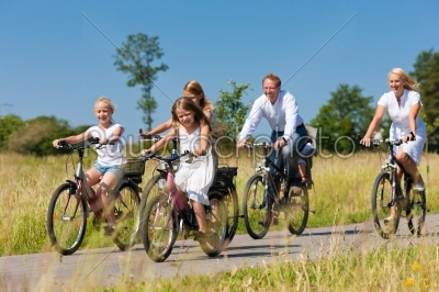 stock photo: family cycling outdoors in summer-Raw Stock Photo ID: 42164