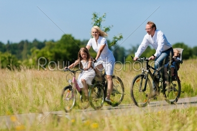 stock photo: family cycling outdoors in summer-Raw Stock Photo ID: 42166