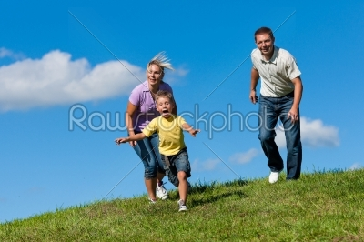 stock photo: family outdoors is running on a meadow-Raw Stock Photo ID: 42854
