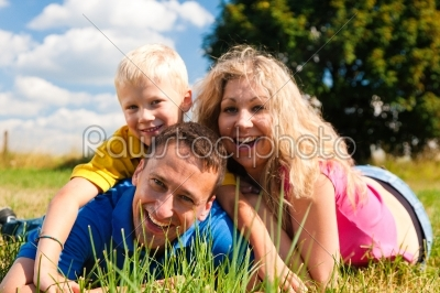 stock photo: family playing tag on meadow in summer -Raw Stock Photo ID: 39884