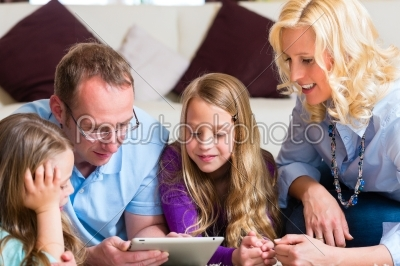stock photo: family playing with tablet computer at home-Raw Stock Photo ID: 44755