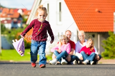 stock photo: family sitting in front of home-Raw Stock Photo ID: 45311