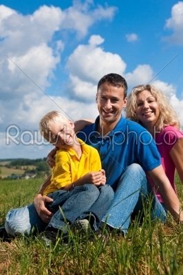 stock photo: family sitting on meadow-Raw Stock Photo ID: 39873