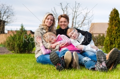 stock photo: family sitting together on a meadow in spring-Raw Stock Photo ID: 44510