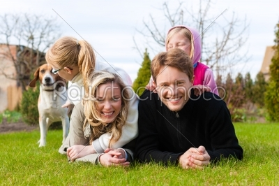 stock photo: family sitting with dogs together on a meadow-Raw Stock Photo ID: 44517