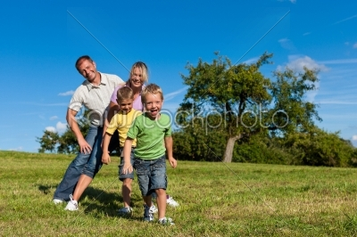 stock photo: family with children playing on a meadow-Raw Stock Photo ID: 42878