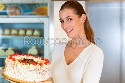 stock photo: female baker or pastry chef with torte-Raw Stock Photo ID: 43318