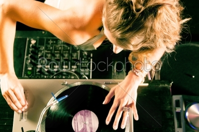 stock photo: female dj at the turntable in club-Raw Stock Photo ID: 40368