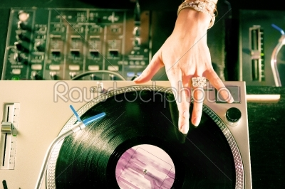 stock photo: female dj at the turntable in club-Raw Stock Photo ID: 40370