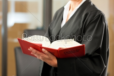 stock photo: female lawyer with german civil code-Raw Stock Photo ID: 42611