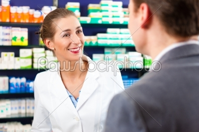 stock photo: female pharmacist consulting a customer in pharmacy-Raw Stock Photo ID: 41137