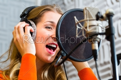stock photo: female singer or musician for recording in studio-Raw Stock Photo ID: 38632
