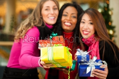 stock photo: friends christmas shopping with presents in mall-Raw Stock Photo ID: 41037
