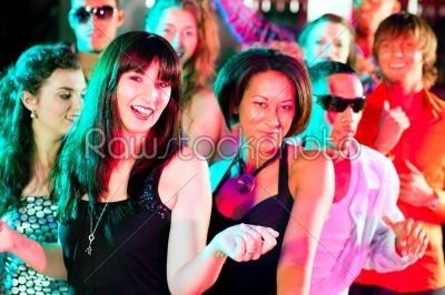 stock photo: friends dancing in club or disco-Raw Stock Photo ID: 39676