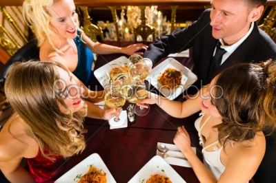 stock photo: friends in a very good restaurant clink glasses-Raw Stock Photo ID: 46629