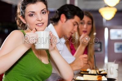 stock photo: friends in restaurant eating and drinking-Raw Stock Photo ID: 39244