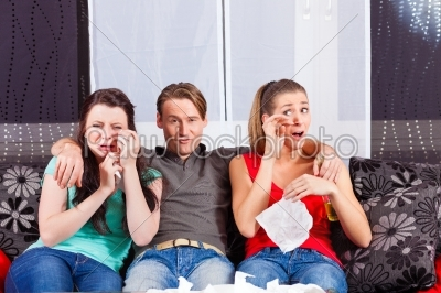 stock photo: friends watching a sad movie in tv-Raw Stock Photo ID: 39256