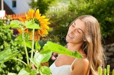 stock photo: garden in summer  happy woman with flowers-Raw Stock Photo ID: 42513