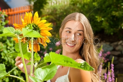 stock photo: garden in summer  happy woman with flowers-Raw Stock Photo ID: 42516